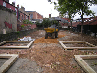 Grapes Hill Community Garden - Putting in raised bed foundations and granite setts