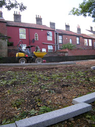 Grapes Hill Community Garden - Stone edging in place